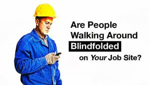 Construction worker texting while walking.